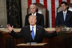 In this Jan. 30, 2018 file photo, President Donald Trump delivers his State of the Union address to a joint session of Congress on Capitol Hill in Washington.