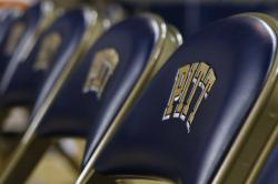 "This Jan. 8, 2015, file photo shows a row of chairs with the ""Pitt"" logo, for the University of Pittsburgh before an NCAA college basketball game in Pittsburgh"