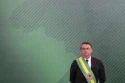 In this Jan. 1, 2019, file photo, Brazil's President Jair Bolsonaro looks on as he presents his cabinet at the Planalto Presidential palace, in Brasilia, Brazil