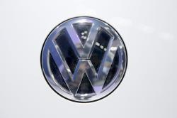 In this Wednesday, Feb. 3, 2016, photo, Volkswagen logo is seen on a vehicle displayed at the Auto Expo in Greater Noida, near New Delhi, India