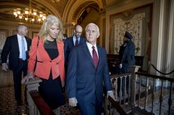 Vice President Mike Pence and counselor to the President Kellyanne Conway, leave Pence's office off the Senate floor in the Capitol building.