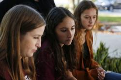"In this Wednesday, Jan. 16, 2019, photo, Brianna Fisher, 16, left, Leni Steinhardt, 16, center, and Brianna Jesionowski sit during an interview with The Associated Press about a new book called ""Parkland Speaks: Survivors from Marjory Stoneman Douglas Share Their Stories,"" in Parkland, Fla."