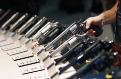 In this Jan. 19, 2016 file photo, handguns are displayed at the Smith & Wesson booth at the Shooting, Hunting and Outdoor Trade Show in Las Vegas