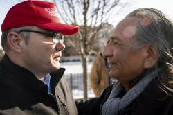 Guy Jones, left, and a supporter of President Donald Trump named Don embrace during a gathering of Native American supporters in front of the Catholic Diocese of Covington in Covington, Ky., Tuesday, Jan. 22, 2019