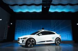 In this March 27, 2018 file photo, the Jaguar I-Pace vehicle outfitted with Waymo's suite of sensors and radar is introduced in New York