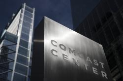 This May 21, 2018, file photo shows a sign outside the Comcast Center in Philadelphia. Comcast Corp. reports financial results Wednesday, Jan. 23, 2019