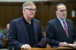 Actor Alec Baldwin, left, stands with his attorney.