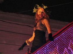Patricia Clarkson holds on as she rides in the Muses Mardi Gras Parade through the streets of New Orleans.