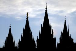 The angel Moroni statue, silhouetted against the sky, sits atop the Salt Lake Temple at Temple Square in Salt Lake City.