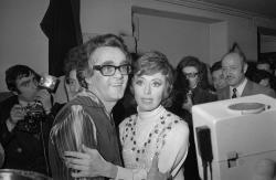 In this Jan. 20, 1972 file picture actress Caterina Valente, right, embraces Michel Legrand after their show at the Olympia in Paris, France.