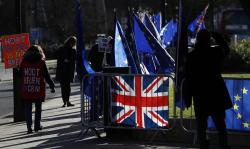 Pro and Anti Brexit protesters demonstrate outside the Houses of Parliament in London, Monday, Jan. 28, 2019