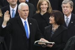 Karen Pence holds a Bible as her husband, Vice President Mike Pence is sworn in during the 58th Presidential Inauguration at the U.S. Capitol in Washington.