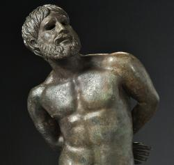 "This image made available on Monday Feb. 4, 2019 by Musee Departemental Arles Antique shows a bronze ""Statue of a captive"" dating from the first century B.C."