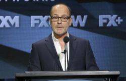 In this Aug. 3, 2018 file photo, John Landgraf, CEO, FX Networks and FX Productions, participates in the executive panel during the FX Television Critics Association Summer Press Tour in Beverly Hills, Calif.