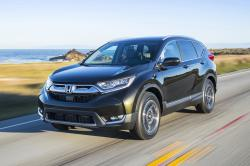 This undated photo provided by Honda shows the 2019 Honda CR-V. Two of the best-selling small SUVs on the market today are the Honda CR-V and the Toyota RAV4