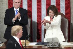President Donald Trump turns to House speaker Nancy Pelosi of Calif., as he delivers his State of the Union address to a joint session of Congress on Capitol Hill in Washington, as Vice President Mike Pence watches.