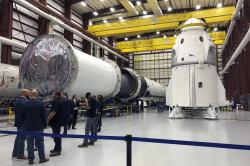 In this Tuesday, Dec. 18, 2018 file photo, SpaceX's Dragon capsule, right, sits in a SpaceX hangar in Cape Canaveral, Fla.