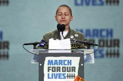 "In this March 24, 2018 file photo, Emma Gonzalez, a survivor of the mass shooting at Marjory Stoneman Douglas High School in Parkland, Fla., closes her eyes and cries as she stands silently at the podium for the amount of time it took the Parkland shooter to go on his killing spree during the ""March for Our Lives"" rally in support of gun control in Washington"
