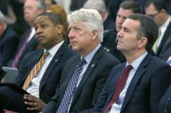In this Dec. 18, 2017 file photo, from left, Lt. Governor-elect Justin Fairfax, Attorney General-elect Mark Herring and Governor-elect Ralph Northam.