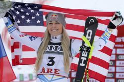 Bronze medalist United States' Lindsey Vonn celebrates after the women's downhill race, at the alpine ski World Championships in Are, Sweden, Sunday, Feb. 10, 2019. (AP Photo/Shinichiro Tanaka)