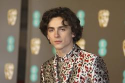 Actor Actor Timothee Chalamet poses for photographers upon arrival at the BAFTA awards in London, Sunday, Feb. 10, 2019. (Photo by Vianney Le Caer/Invision/AP)