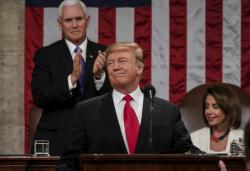 In this Feb. 5, 2019 photo, President Donald Trump gives his State of the Union address to a joint session of Congress, at the Capitol in Washington, as Vice President Mike Pence, left, and House Speaker Nancy Pelosi look on