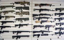 In this photo taken Oct. 2, 2018, semi-automatic rifles fill a wall at a gun shop in Lynnwood, Wash.