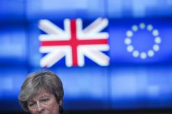 Britain's Prime Minister Theresa May talks to journalists after her meeting with European Council President Donald Tusk at the European Council headquarters in Brussels, Thursday, Feb. 7, 2019