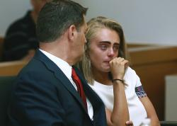 In a Thursday, Aug. 3, 2017 file photo, Michelle Carter awaits her sentencing in a courtroom in Taunton, Mass., for involuntary manslaughter for encouraging Conrad Roy III to kill himself in July 2014