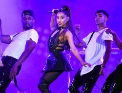 Ariana Grande, center, performs at Wango Tango in Los Angeles.