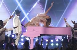Ne-Yo, left, and Jennifer Lopez perform a medley during a tribute to Motown's 60th anniversary at the 61st annual Grammy Awards.