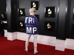 Ricky Rebel arrives at the 61st annual Grammy Awards.