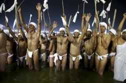 Hindu men perform prayers for becoming Naga Sadhus or naked holy men at Sangam.