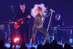 "Lady Gaga, right, and Mark Ronson perform ""Shallow"" at the 61st annual Grammy Awards."
