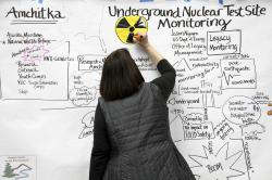 Anne M. Jess, of The Doodle Biz of Seattle, creates a graphic representation of a U.S. Department of Energy presentation addressing earthquake damage to some mud disposal sites and sampling results from radiologic monitoring on Amchitka Island during a forum Tuesday, Feb. 12, 2019, in Anchorage, Alaska
