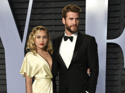 Miley Cyrus, left, and Liam Hemsworth
