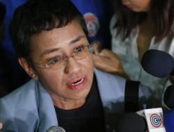 Maria Ressa, the award-winning head of a Philippine online news site Rappler, talks to the media after posting bail at a Regional Trial Court following an overnight arrest by National Bureau of Investigation agents on a libel case Thursday, Feb. 14, 2019 in Manila, Philippines