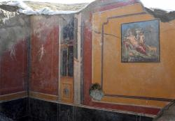 This undated photo provided Thursday, Feb. 14, 2019 by the Parco Archeologico di Pompei (Archeological Park of Pompei) shows the atrium of a house with a fresco portraying the mythological hunter Narcissus, right, in Pompeii, near Naples, Italy