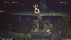 This photo provided by Paul G. Allen's Vulcan Inc. shows a five inch gun at the wreckage of the USS Hornet