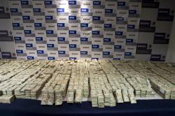 In this Sept. 18, 2008, file photo, cash seized by Mexico's Army, which according to the Defense Department was seized on Sept. 14 from the Sinaloa drug cartel and is displayed to the press in Mexico City