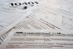 This Wednesday, Feb. 13, 2019, in Zelienople, Pa., shows multiple forms printed from the Internal Revenue Service web page that are used for 2018 U.S. federal tax returns