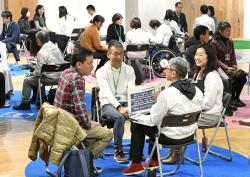 In this Feb. 9, 2019, photo, invitees have interviews during an orientation meeting for volunteers for the Tokyo 2020 Olympics and Paralympics in Tokyo