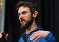 Travis Kauffman responds to questions during a news conference Thursday, Feb. 14, 2019, in Fort Collins, Colo., about his encounter with a mountain lion while running a trail just west of Fort Collins last week