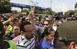 U.S. Senator Marco Rubio, R-Fla., greets Venezuelan migrants near the Simon Bolivar International Bridge, which connects Colombia with Venezuela, in La Parada, near Cucuta, Colombia, Sunday, Feb. 17, 2019
