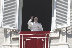 Pope Francis delivers his blessing during the Angelus noon prayer In St. Peter's Square at the Vatican, Sunday, Feb. 17, 2019. (AP Photo/Gregorio Borgia)