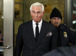 In this Feb. 1, 2019, file photo, former campaign adviser for President Donald Trump, Roger Stone, leaves federal court in Washington