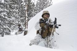 A U.S. Marine takes his position during advanced cold-weather training at the Marine Corps Mountain Warfare Training Center Sunday, Feb. 10, 2019, in Bridgeport, Calif.