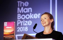 "In this Oct. 16, 2018 file photo, author Anna Burns smiles after being presented with the Man Booker Prize for Fiction 2018 for ""Milkman,"" during the prize's 50th year at the Guildhall in London"