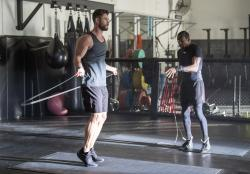 Actor Chris Hemsworth, left, and Michael Olajide Jr. workout.