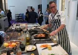 Celebrity chef Brian Malarkey during a cooking demonstration at the GE Appliance display during the Design and Construction Week show.